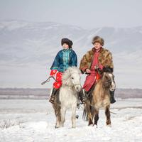 Mongolian Couple on horseback in the winter