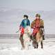 mongolian-couple-on-horseback-in-the-winter
