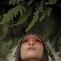 Native American girl looking up and praying