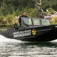 Officer in Patrol Boat on the water