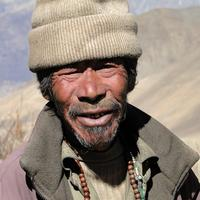 Old man in Nepal with a Weather Beaten Face