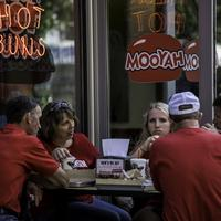 People eating outside Mooyahs in Madison, Wisconsin