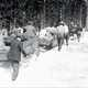 People pulling sleds through the snow 1929