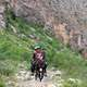 people-riding-a-donkey-on-a-mountain-path