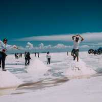 people-standing-on-top-of-salt-mounds