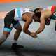 People wrestling in a match