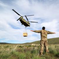Soldier signaling landing for helicopter supplies