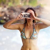 Pretty Woman taking a photo in Bikini