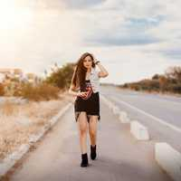 pretty-woman-walking-on-the-side-of-the-road