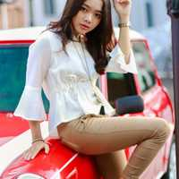 pretty-young-girl-on-red-car