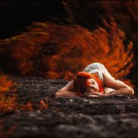 Red Haired girl lying on the ground