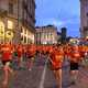 Runners wearing red shirts in a race