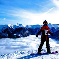 Snowboarder on the mountain in the winter