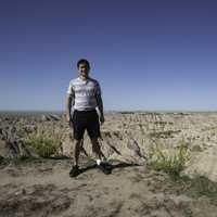 Standing on the edge of a cliff at Badlands National Park