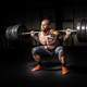 Strong man squatting lots of weight
