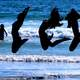 three-girls-jumping-on-the-beach