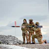 Three Soldiers firing a rocket launchers