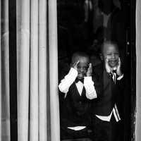 two-african-american-kids-looking-through-window