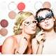two-girls-in-a-photo-booth-with-masks