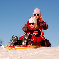 Two kids on a sled