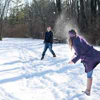 two-people-snowball-fighting-in-the-winter