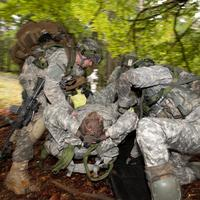 Two Soldiers putting a third one into a stretcher