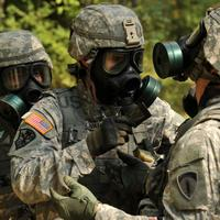 Two Soldiers wearing Gas Masks