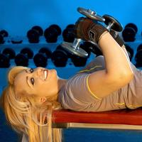 Woman at Gym lifting Free weights
