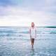 woman-dress-in-white-standing-in-the-sea