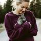 woman-in-purple-shirt-holding-a-kitten