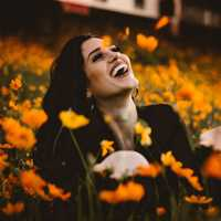 woman-laughing-in-orange-flowers