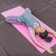 Woman on a Pink Mat doing yoga