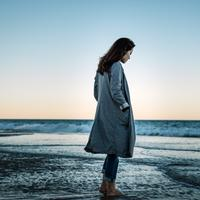 Woman on the beach in a coat