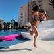 Woman playing with soccer ball at a resort