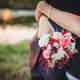 woman-with-arms-wrapped-around-a-man-with-bouquet-flowers