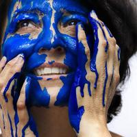 Woman with blue face paint