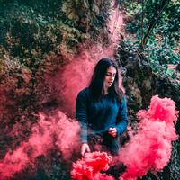 Woman with pink smoke