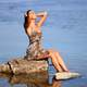 women-sitting-by-the-water-in-leopard-dress