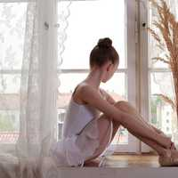 young-ballerina-dancer-sitting-at-the-window