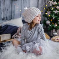 Young Child next to the Christmas