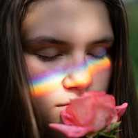 young-girl-face-with-rainbow-on-it