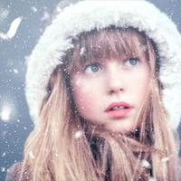 Young girl staring at the snowfall