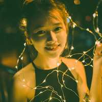 Young Girl with Black Dress with lights