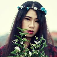 Young Girl with flower crown and white flowers