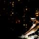 young-women-sitting-at-night-looking-at-small-lights
