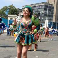 Woman in festival costume dancing in Lima, Peru