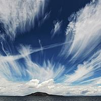 Clouds and Sky with an Island in lake Titicaca in Peru
