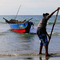 Fisherman bringing in the boat in the Philippines