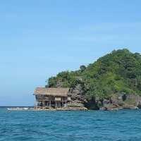Island with house in the ocean in the Philippines
