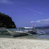 Puerto Galera with a boat in the sea